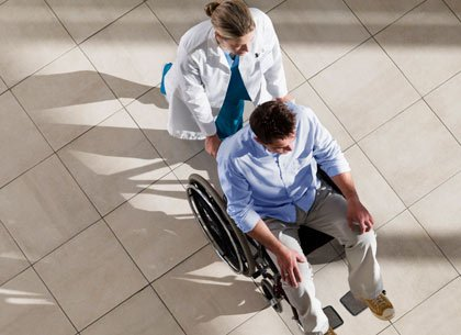 nurse pushing patient in wheel chair