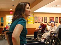 Student in wheelchair - Learning by Living program sends medical students into nursing homes to learn how older people live.