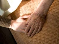 Author Byock researches better palliative care- mature and younger hand