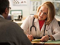 Woman doctor talks to patient, Boutique doctors and concierge medicine