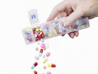 Pills falling from pillbox