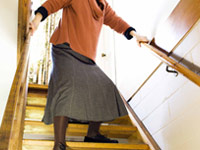 Anti-depressants are linked to nursing home falls - woman on stairs