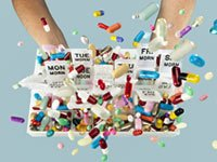 Tossing pills in the air from weekly medicine container. Side effects of prescribed drugs.