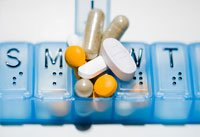 Taking multiple medications and vitamin supplements may be too much- a pillbox full of medication and vitamin pills