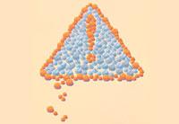 illustration of pills forming a warning symbol