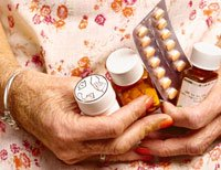 70 year old woman cleans out expired medication