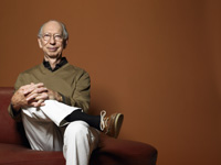 Portrait of senior man on sofa.