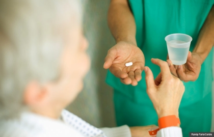 Nurse Bringing Patient His Medication, A drugmaker improperly marketed Megace to frail seniors in nursing homes.