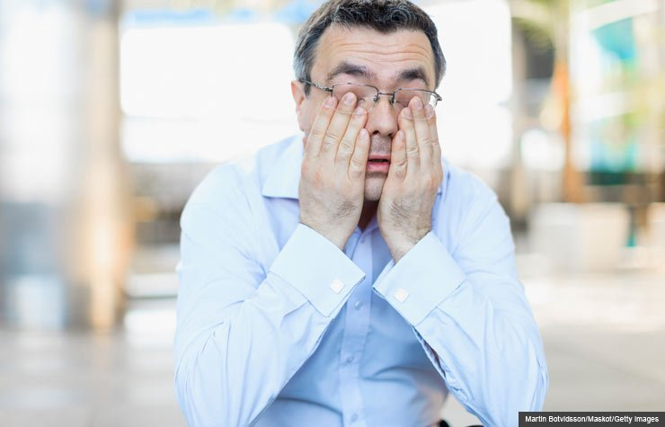 Drowsy man rubbing eyes, Potential risks of using sleeping aids (Martin Botvidsson/Maskot/Getty Images)