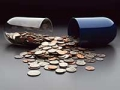 USA coins spilling out of broken capsule, The Spiraling Price of Cancer Drugs