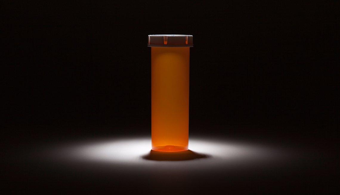 A drug vial under spotlight, dangerous drug shortages