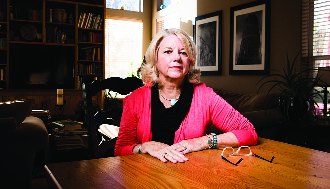 Sue Trevor sits at a table, expensive specialty drugs