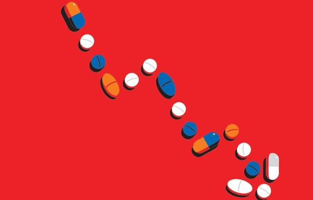Diferentes pastillas sobre un fondo rojo