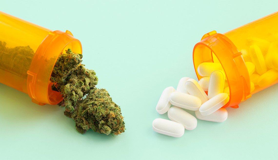 Marijuana and white pills in medicine bottles