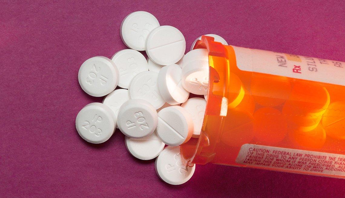 Opioid pills in prescription bottle