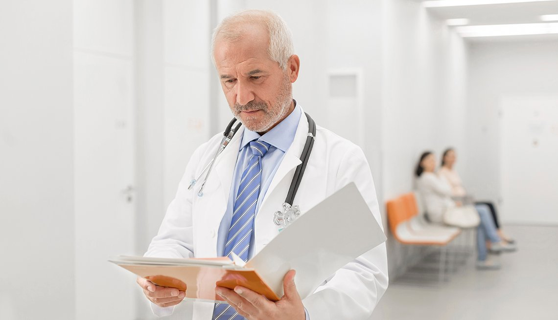 Doctor reading a file or letter