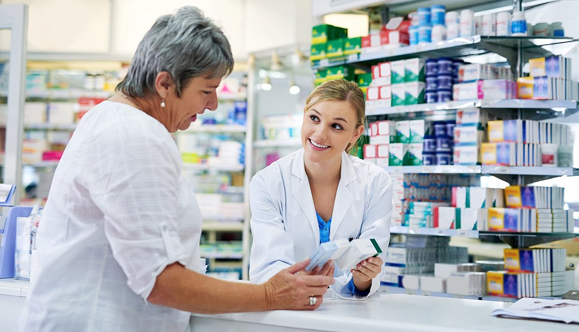 Pharmacist assisting a woman at the counter