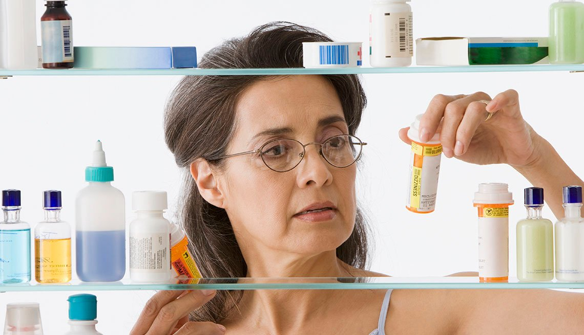 Woman at medicine cabinet
