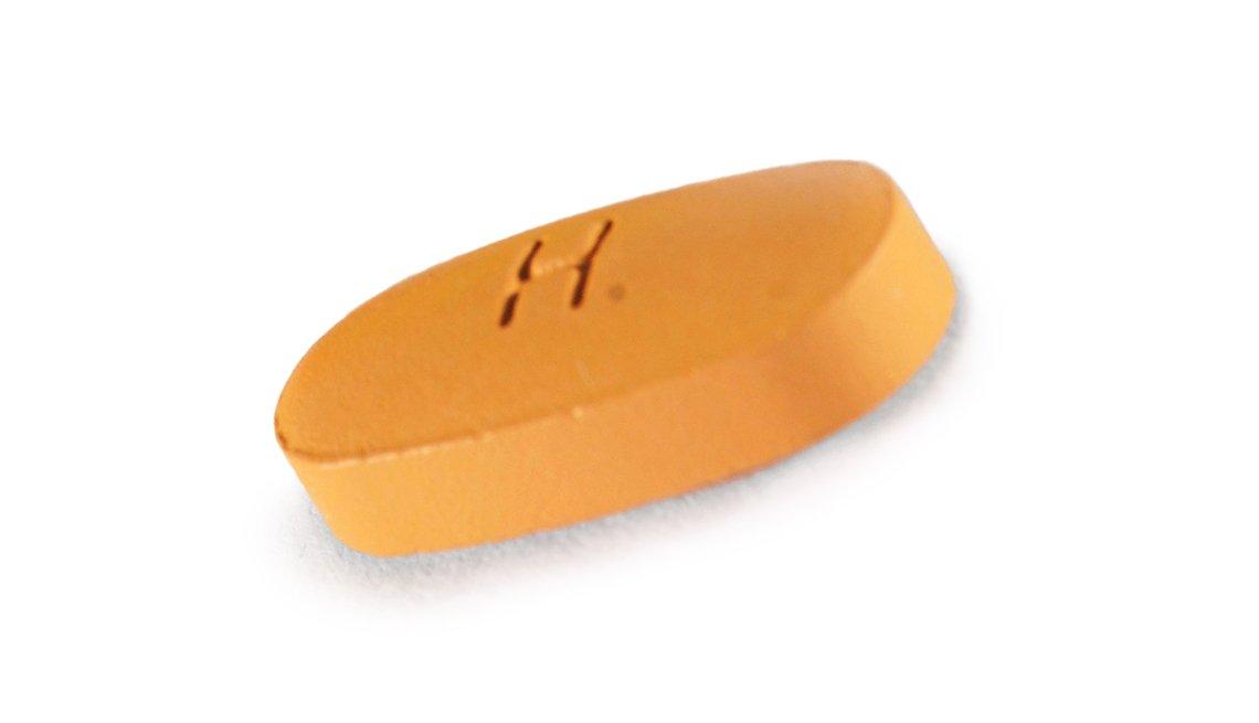 A close-up of a pill form of an A R B or angiotensin II receptor blockers
