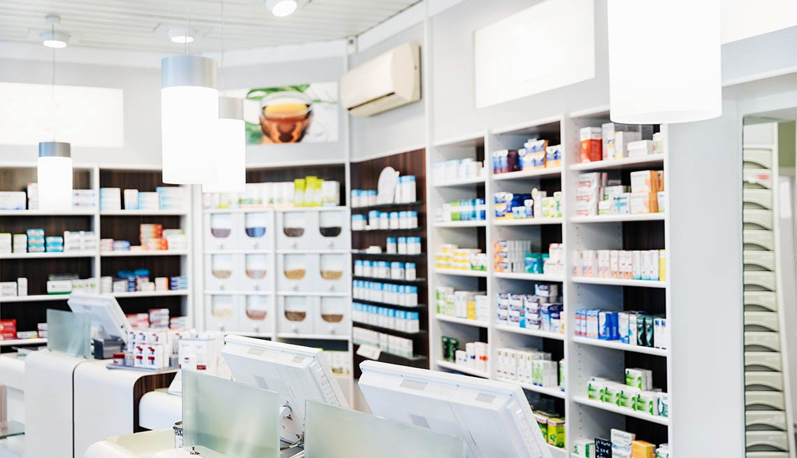 A pharmacy counter before the store has opened, with medicine on display behind the checkouts.
