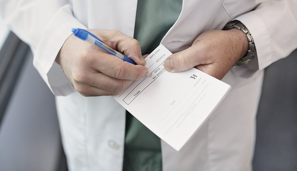 Close up of a doctor filling out a prescription