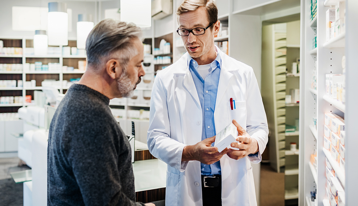 A pharmacist advising a customer