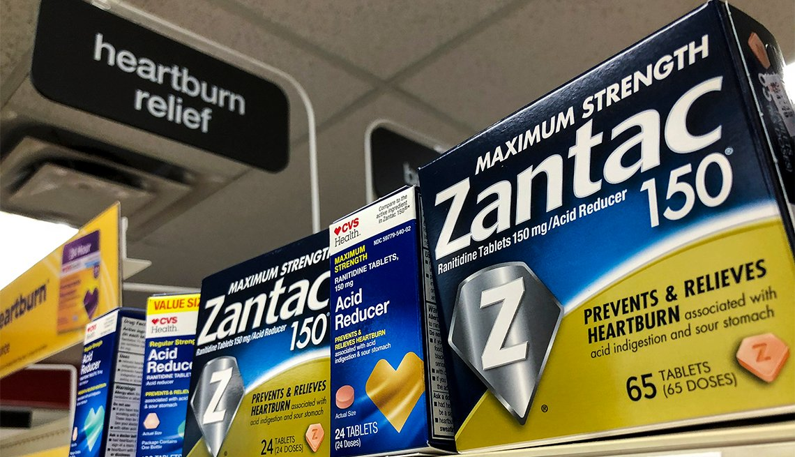 Packages of Zantac, a popular medication which decreases stomach acid production and prevents heartburn, sit on a shelf at a drugstore