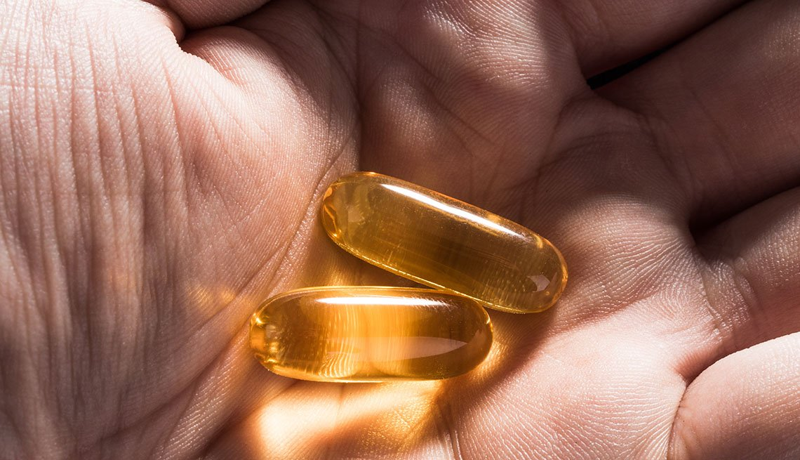 vitamin capsules in palm of hand