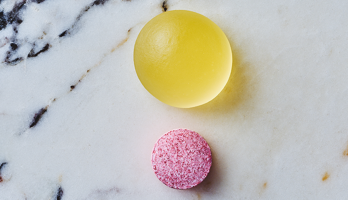 photo of a gold colored chewable vitamin d three supplement and a dissolvable vitamin b twelve supplement