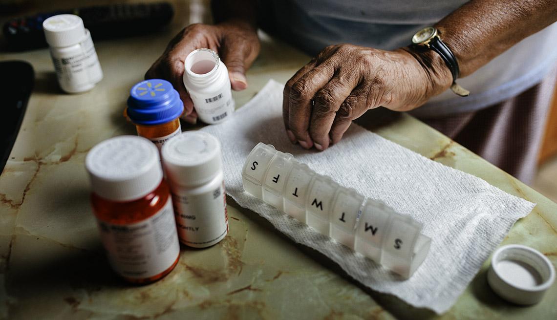 close-up of person sort medications