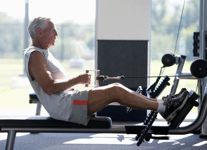 older man training in gym