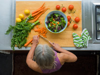 woman making healthy salad