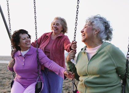 three women on swings