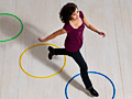 Woman jumping over circles