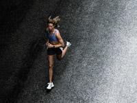 Woman jogging on street