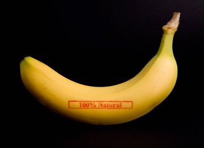 A banana stamped '100% Natural'