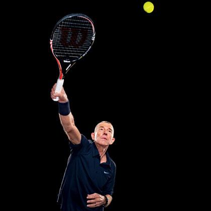 Tennis player trying to return ball