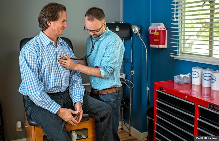Dr. Neuhofel, 32, conducts an exam on Bryan Welch, 54 (Earl R. Richardson)