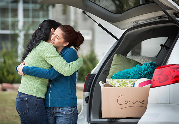 Hispanic mother helping daughter pack for college, 10 Things You Need to Know About the Health Care Law