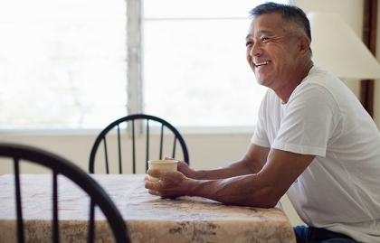 Asian man at dinning table, Medicare Open Enrollment Quiz