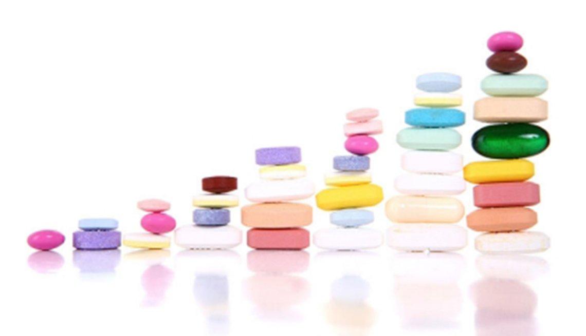 Piles of pills, medication, Medicare Open Enrollment 2014