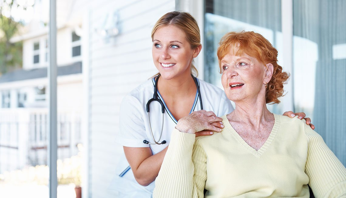 a mature woman reciving care at home by a nurse