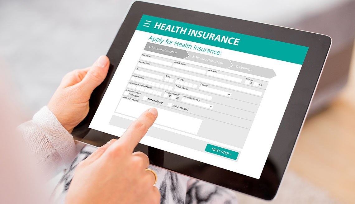 Woman applying for health insurance online
