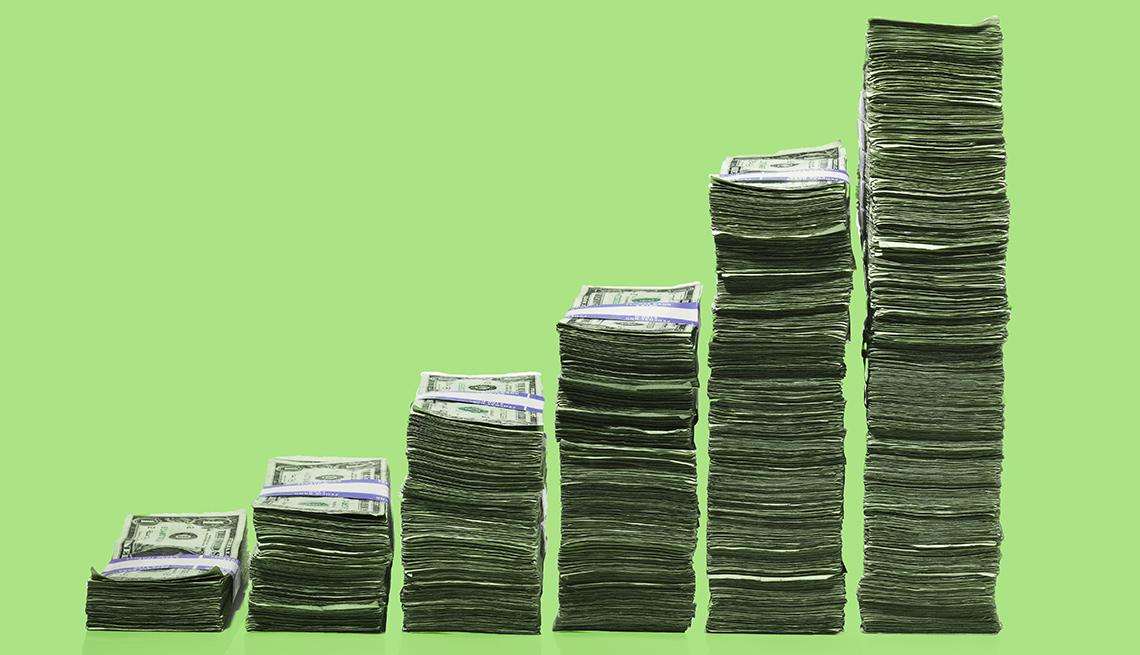 Stacks of dollar bills higher stacks