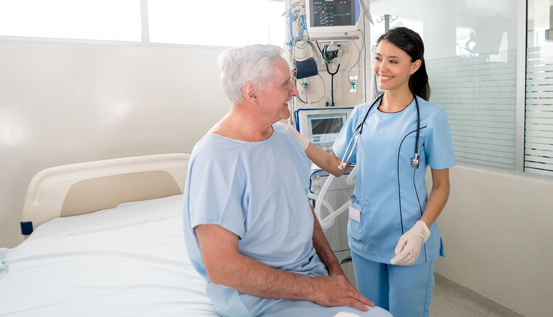 Woman and man speaking in hospital room