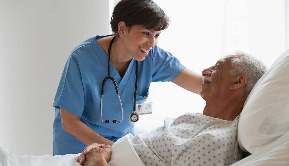 Nurse smiling while talking to a patient