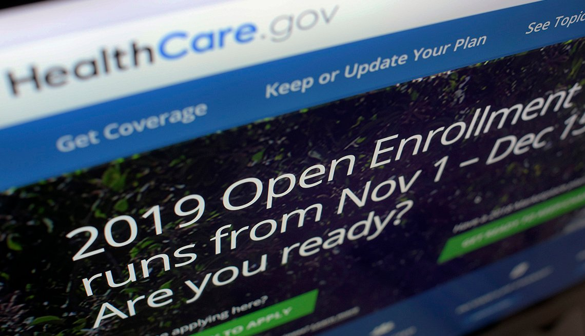 HealthCare.gov website on a computer screen. Text says: 2019 Open Enrollment runs from Nov. 1 to Dec. 15. Are you ready?