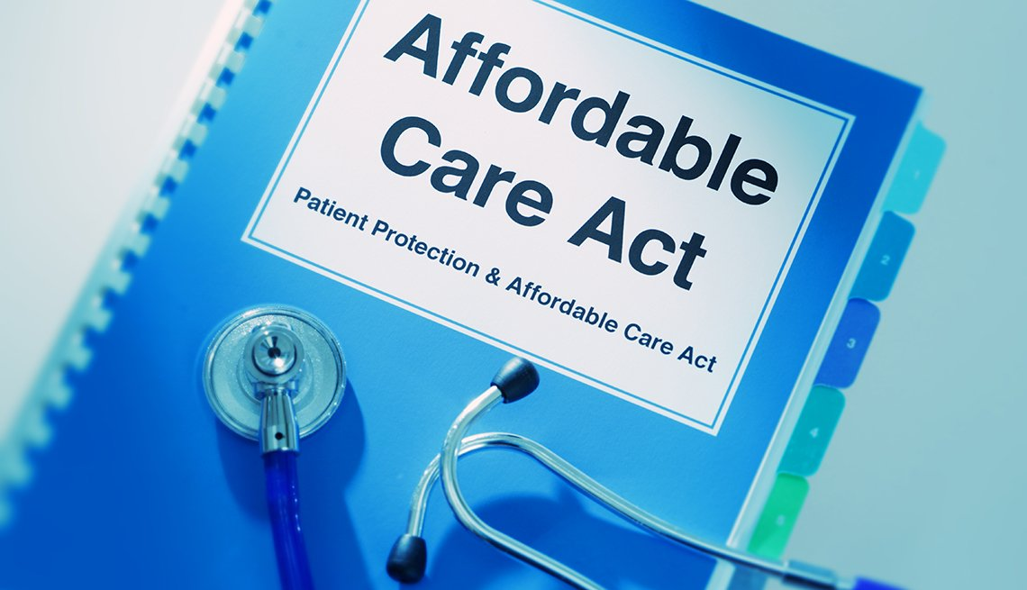 Close-up of a medical stethoscope laying on top of an Affordable Care Act Manual Book.