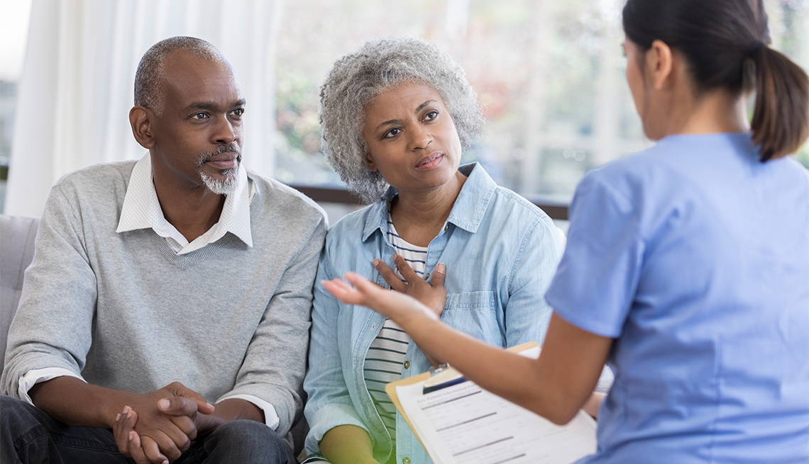 Couple listens to a medical provider.