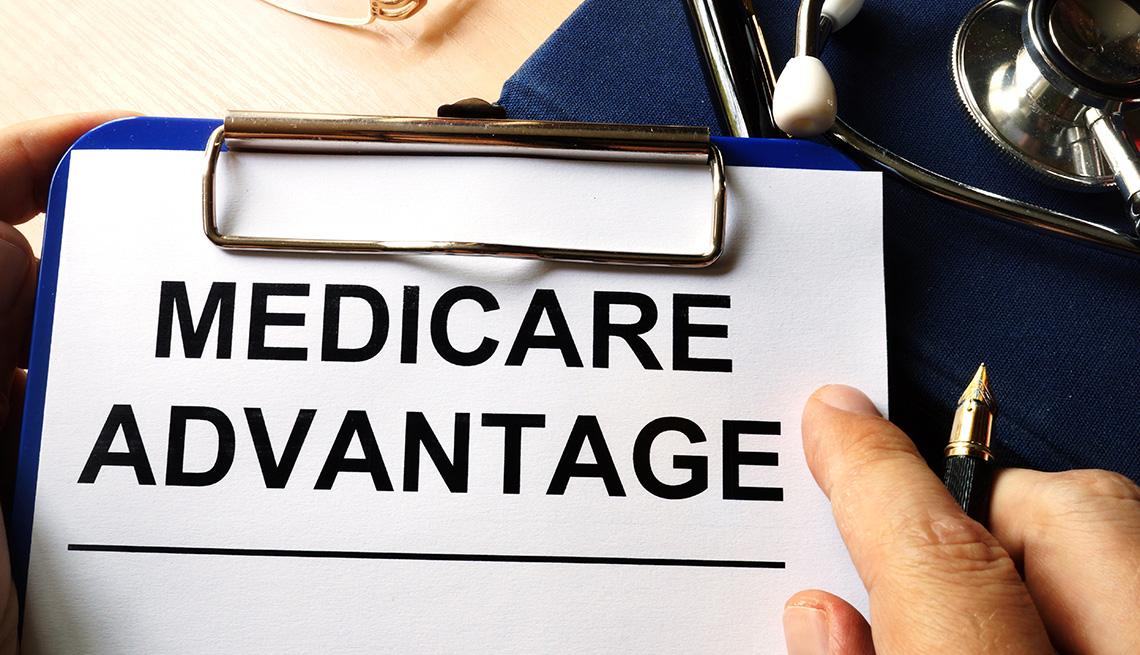 Medicare advantage in a clipboard. Health care insurance concept.